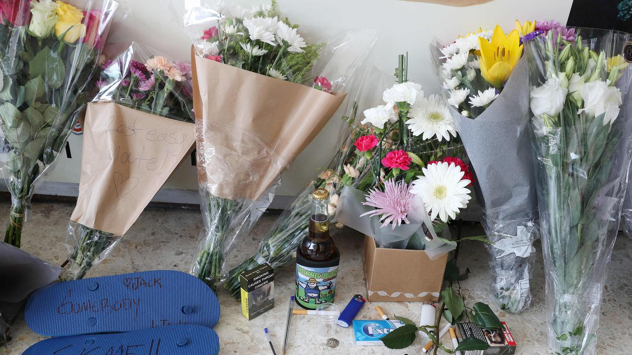 Flowers, handwritten notes and other items left by Jack's friends. Picture: Liam Kidston.