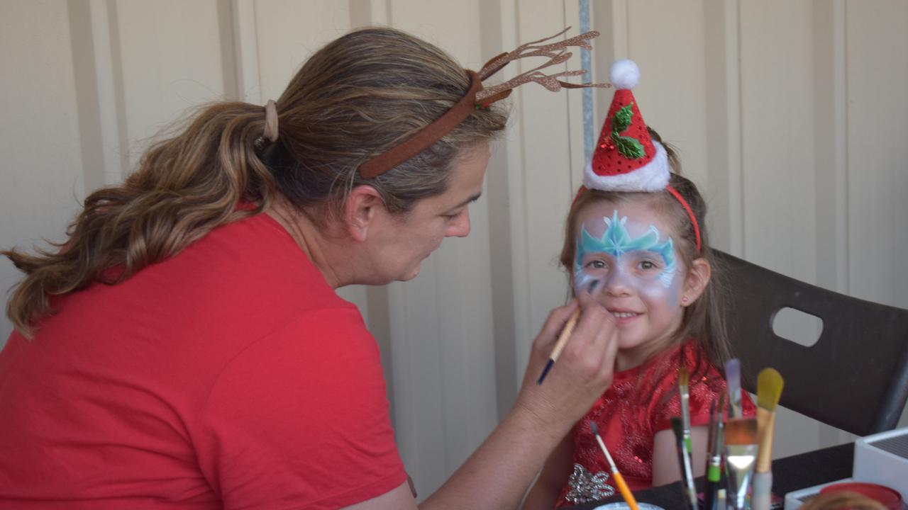 Freya McPhail getting her face painted at the Jandowae community carols event.