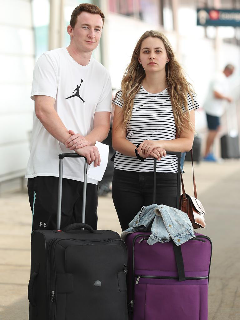 Alex Walkling and Jessica Worboys at Sydney Airport after having their Jetstar flight to Hobart cancelled on Sunday. Picture: Brett Costello