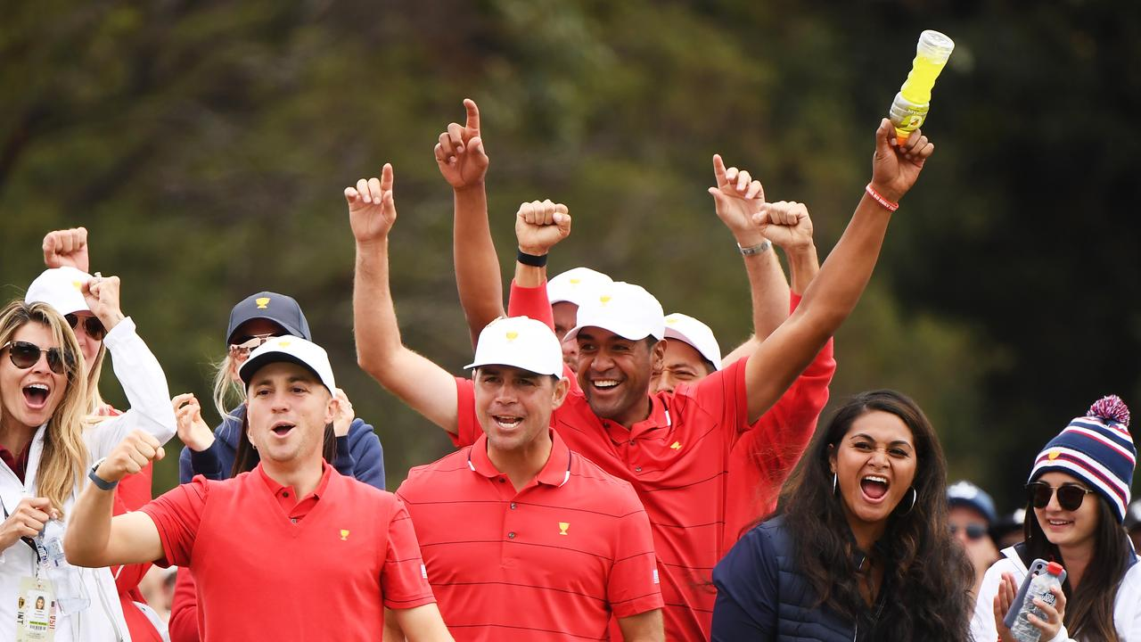 Justin Thomas, Gary Woodland, Tony Finau, Xander Schauffele and Webb Simpson of the United States team celebrate winning the Presidents Cup.
