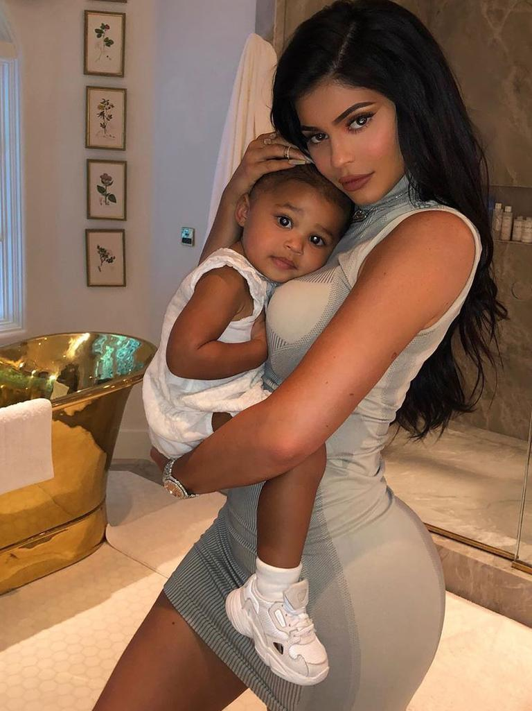 Kylie Jenner and Stormi, in baby Adidas.