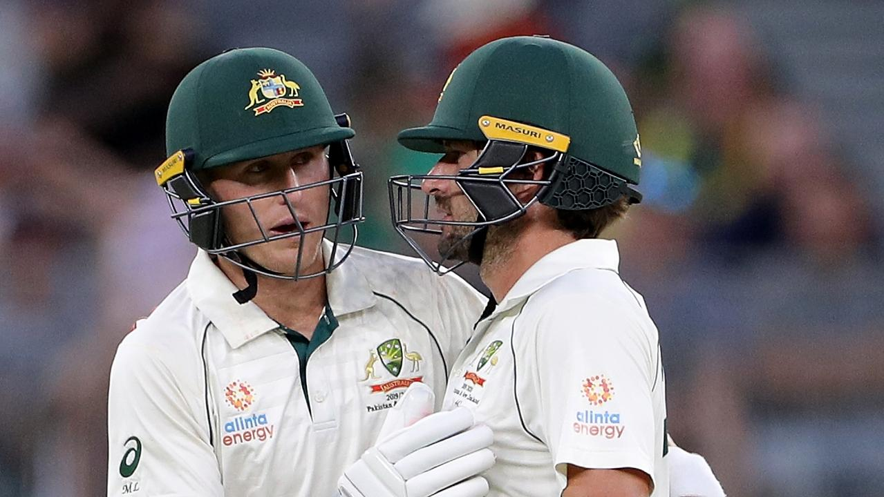 Marnus Labuschagne (left) and Joe Burns shared an 87-run partnership on day three.