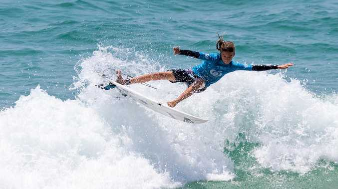 Noosa grom in super form nails surf in Coolum