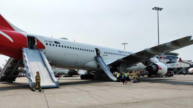 Slides deployed in Qantas emergency