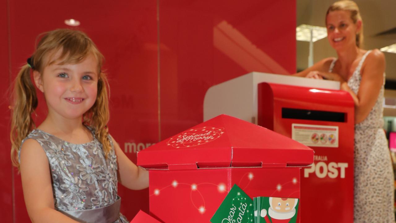 Four year old Billie Jean McCallum posts her letter to Santa at Australia Post. Picture Glenn Hampson