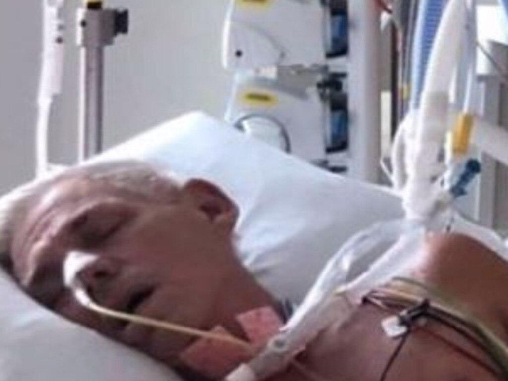 Mooloolaba's Dez Ginns in his bed at Sunshine Coast University Hospital battling Japanese encephalitis.