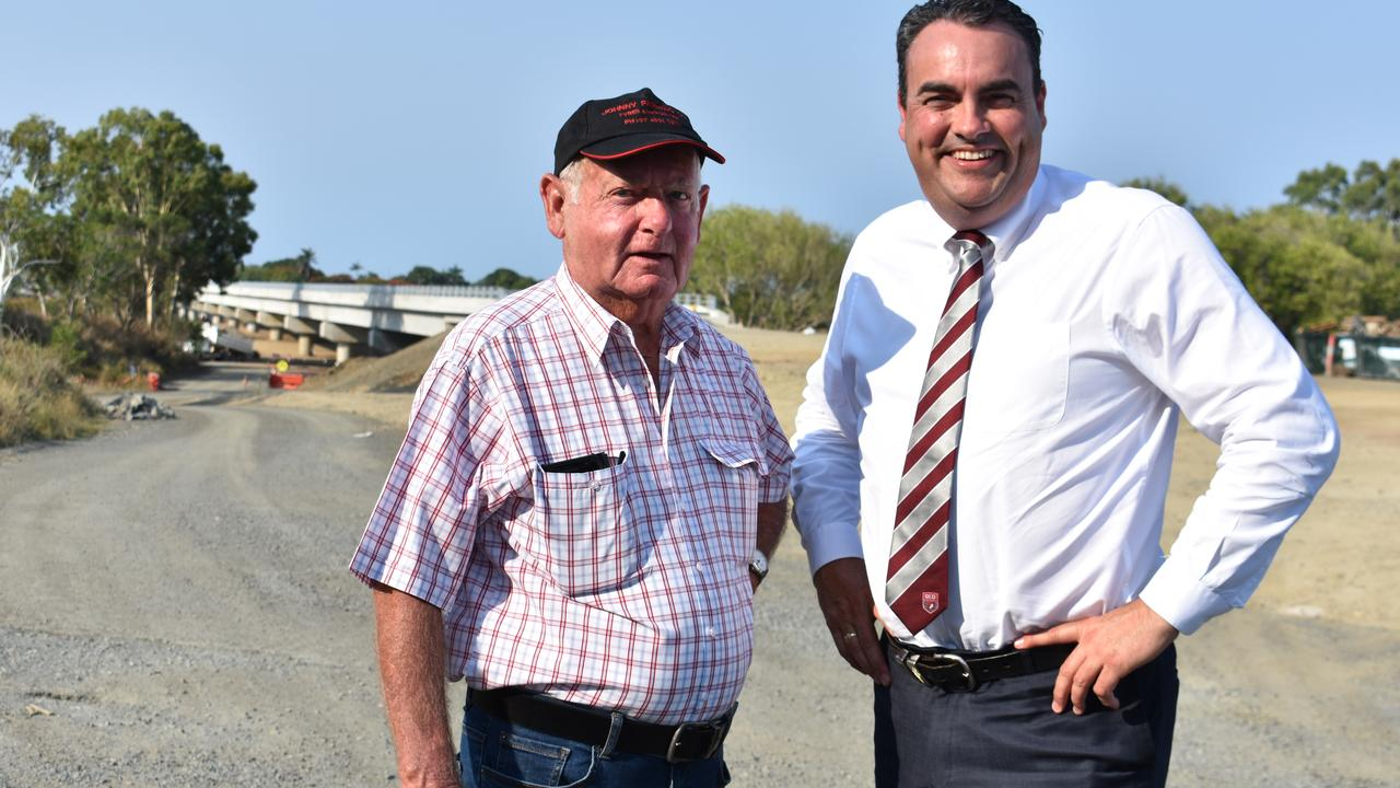 BRIDGE CALL: Sir Arthur Fadden's nephew Ian Fadden and Whitsunday MP Jason Costigan with the Pioneer River bridge in the background. Picture: Melanie Whiting.