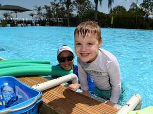 Jackson Smith with swim teacher Jasmine Dooley at the