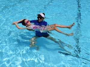 IN THE POOL: Akaia Franklin with swim teacher