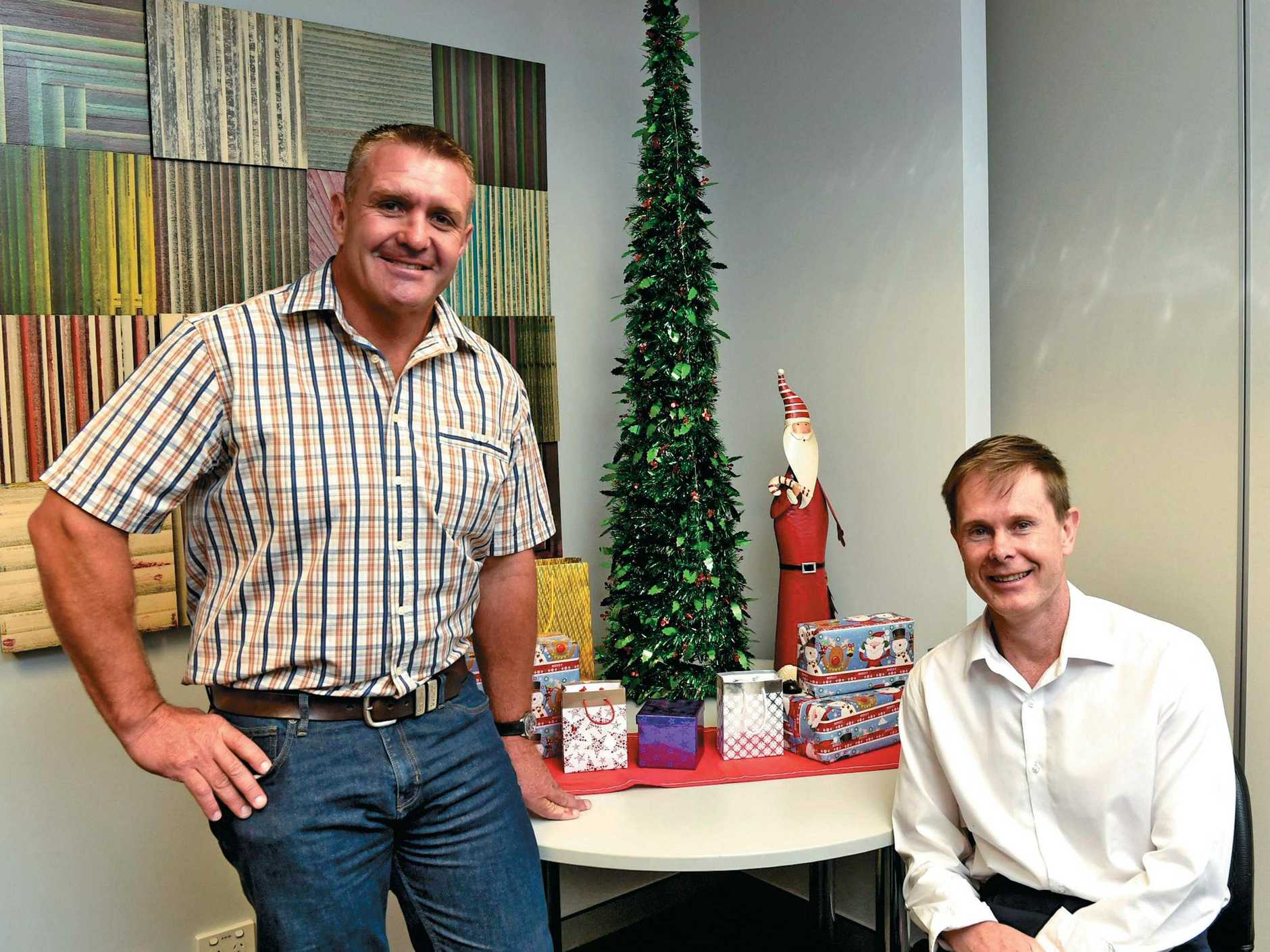 Shane Webcke and The Chronicle regional general manager Rohan Gosstray at an annual Adopt a Family launch.