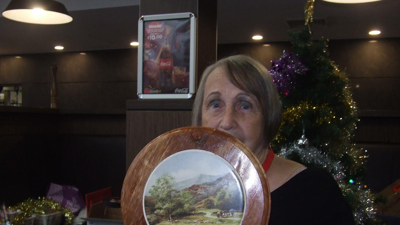 PROUD MOMENT: Rockhampton Men's Shed Secretary/Treasurer Marion Lawler with her Life Membership award.