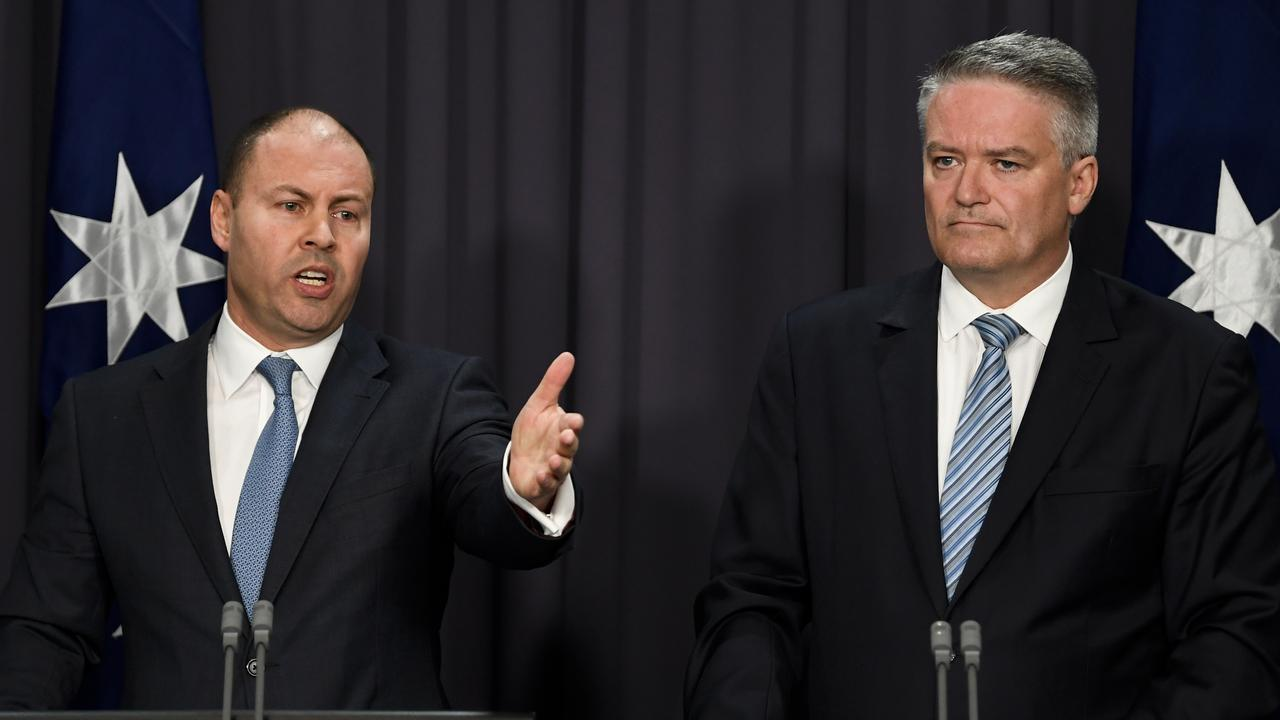 Treasurer Josh Frydenberg (left) and Finance Minister Mathias Cormann hand down the Mid-Year Economic and Fiscal Outlook. Picture: Lukas Coch/AAP