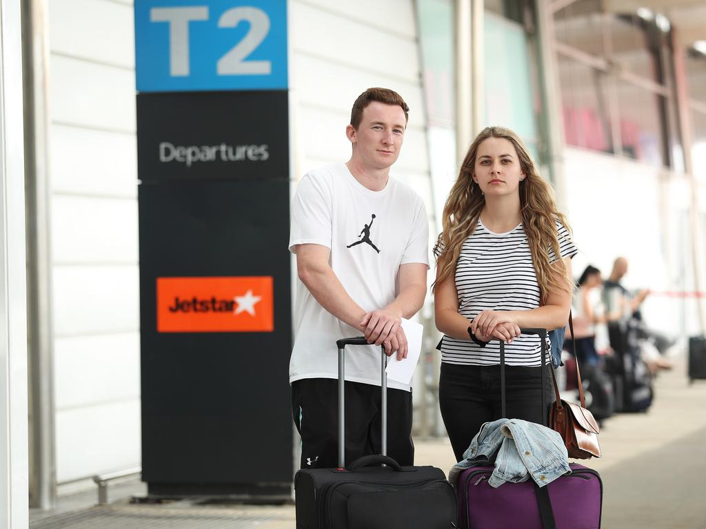 Alex Walkling and Jessica Worboys at Sydney Airport after having their Jetstar flight to Hobart cancelled. Picture: Brett Costello