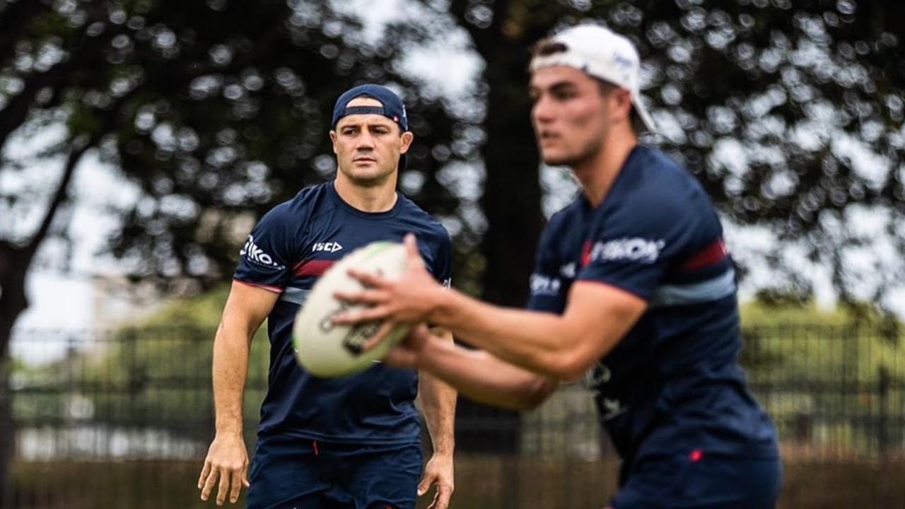 Cronk is helping to guide Flanagan.