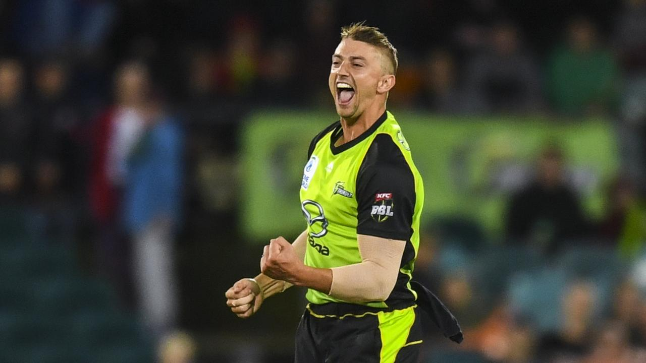 Daniel Sams of the Sydney Thunder celebrates after claiming a wicket