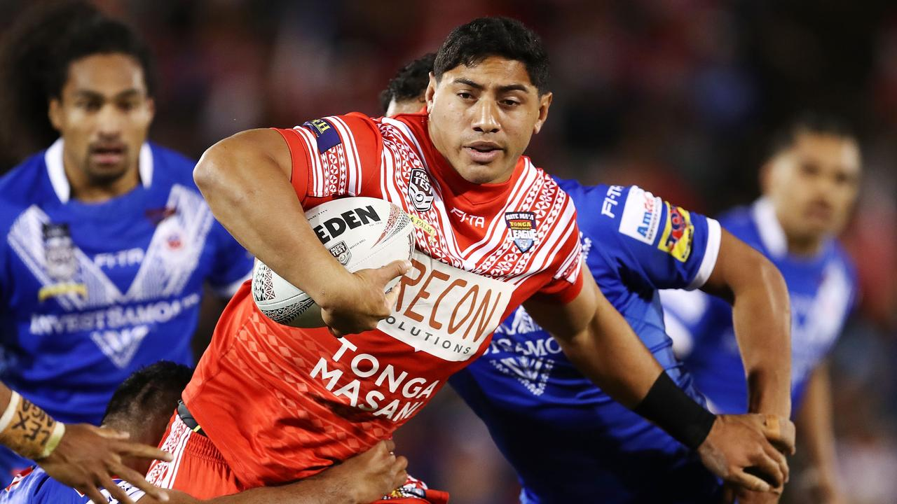 SYDNEY, AUSTRALIA - JUNE 23: Jason Taumalolo of Tonga is tackled by the Samoan defence during the 2018 Pacific Test Invitational match between Tonga and Samoa at Campbelltown Sports Stadium on June 23, 2018 in Sydney, Australia. (Photo by Brendon Thorne/Getty Images)
