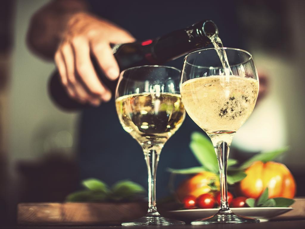 This Christmas, consider switching out a glass of white wine for a low calorie glass of prosecco. Picture: iStock.