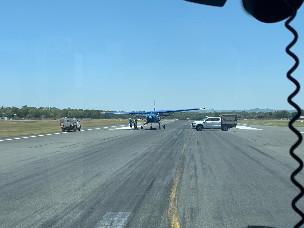 The Skydive Australia plane sits lopsided on the Sunshine Coast Airport runway after flattening a tyre on landing.