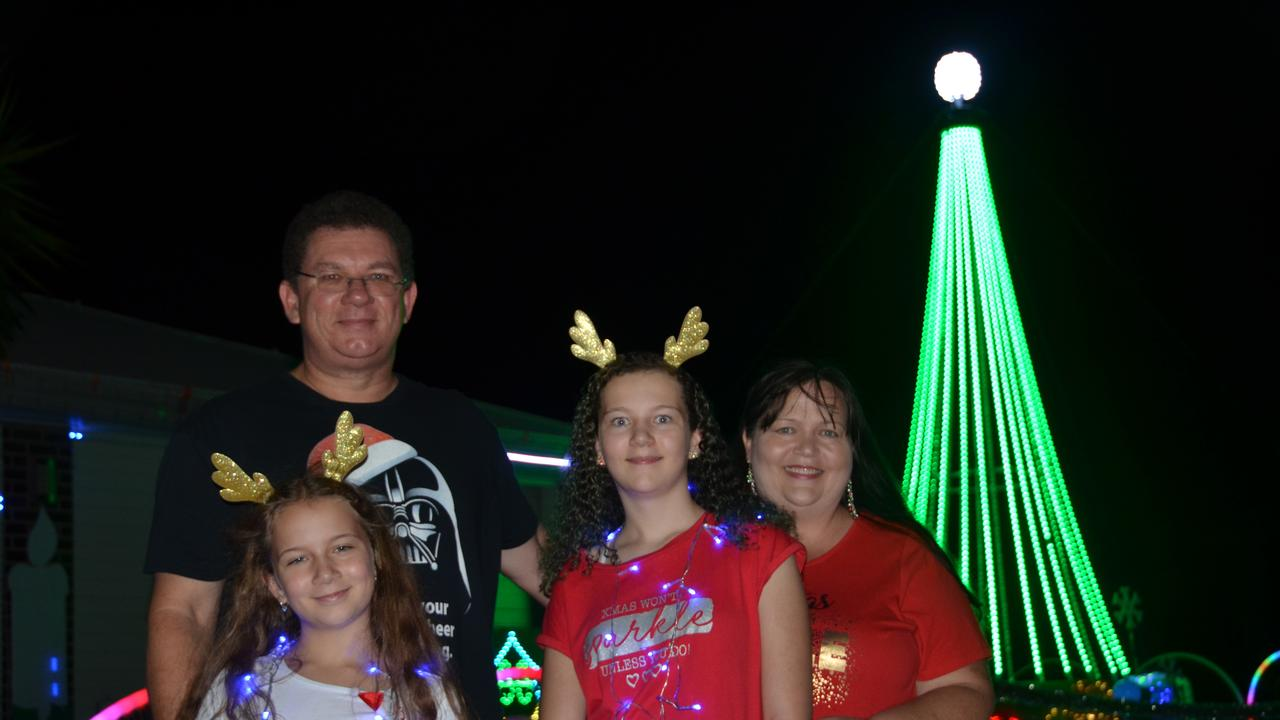 DOING THEIR BIT: Emilia and Selina Parker have been raising funds for farmers in drought this Christmas, with the help of their parents Steve and Robyn Parker. Photo: Madeline Grace