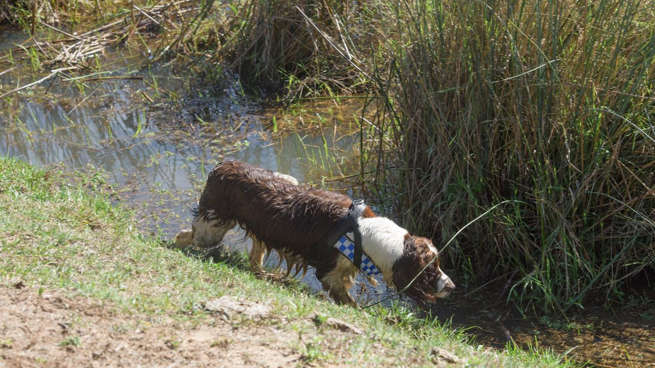 Police dogs search a dam in connection to the disappearance of Sharon Edwards. Her body has never been found.