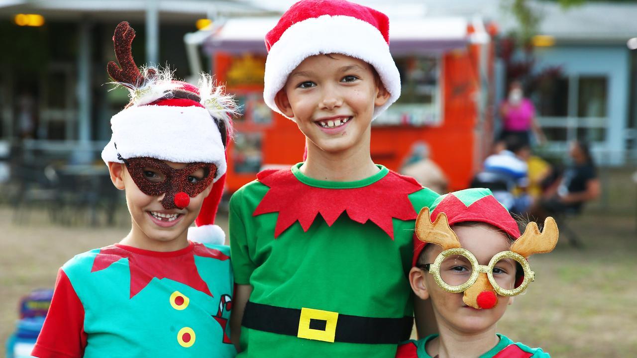 Liam Pope, 6, Lucas Pope, 8, and Alex Pope, 4, enjoy a Community Christmas Carols event. Picture: Brendan Radke.