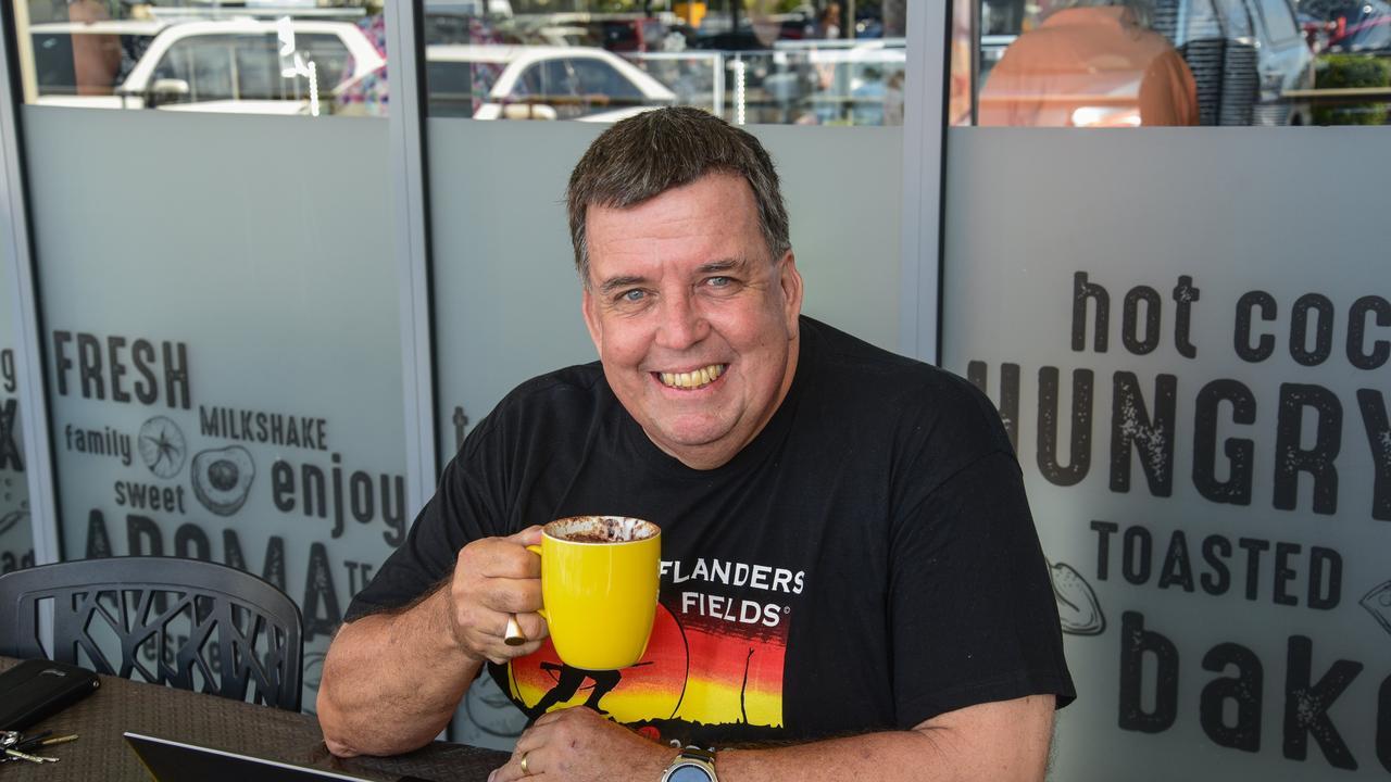 Greg Barnes having a cup of coffee outside the Bargara Bakery.