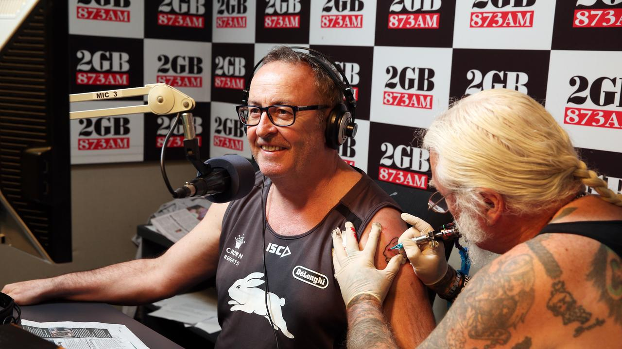 Chris Smith receives a tattoo of a bunny live on air after the Rabbitohs NRL grand final win. Picture Craig Greenhill