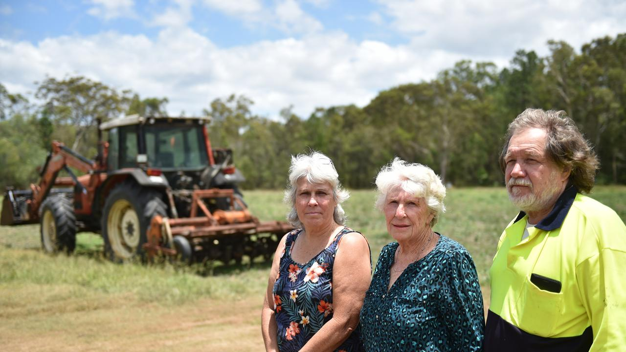 Karen Shires, mother Yvonne Robb and husband Robb Shires stand in front of their Elimbah squash farm crop ruined by Queensland Rail Elimbah Stabling Yard facility.