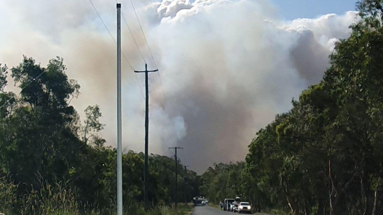 Residents evacuate as a large bushfire pushes towards homes near Lake Weyba. Photo: Contributed