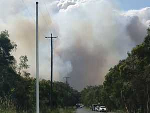 'GET OUT': Residents flee fast-moving bushfire