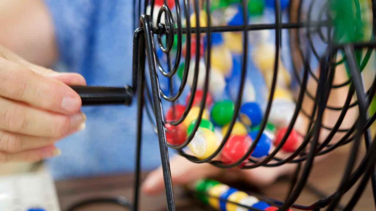 Turning the bingo wheel.