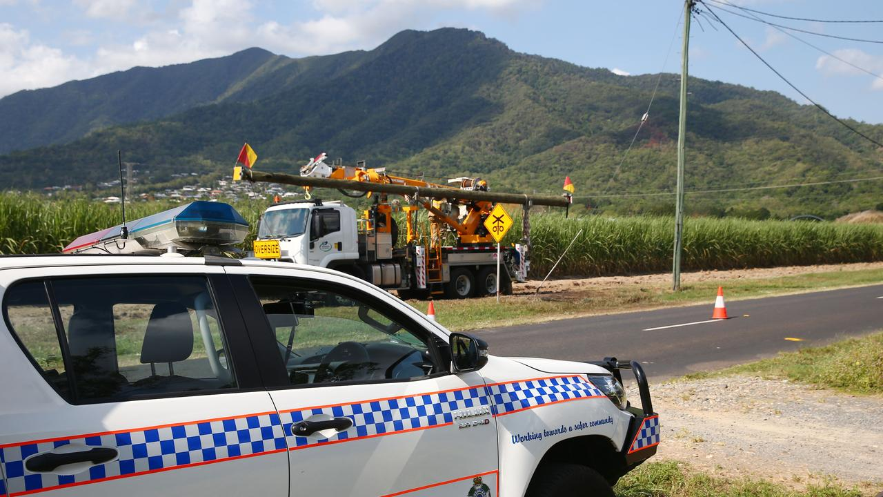 Scene of a fatal traffic crash at Lower Freshwater Road, Kamerunga. Ergon Energy work on restoring power to the area after a Toyota 86 coupe crash into a power pole. PICTURE: BRENDAN RADKE