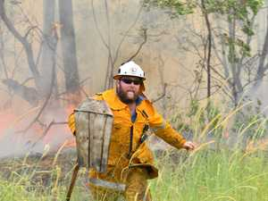Peregian bushfire under control, but warnings remain