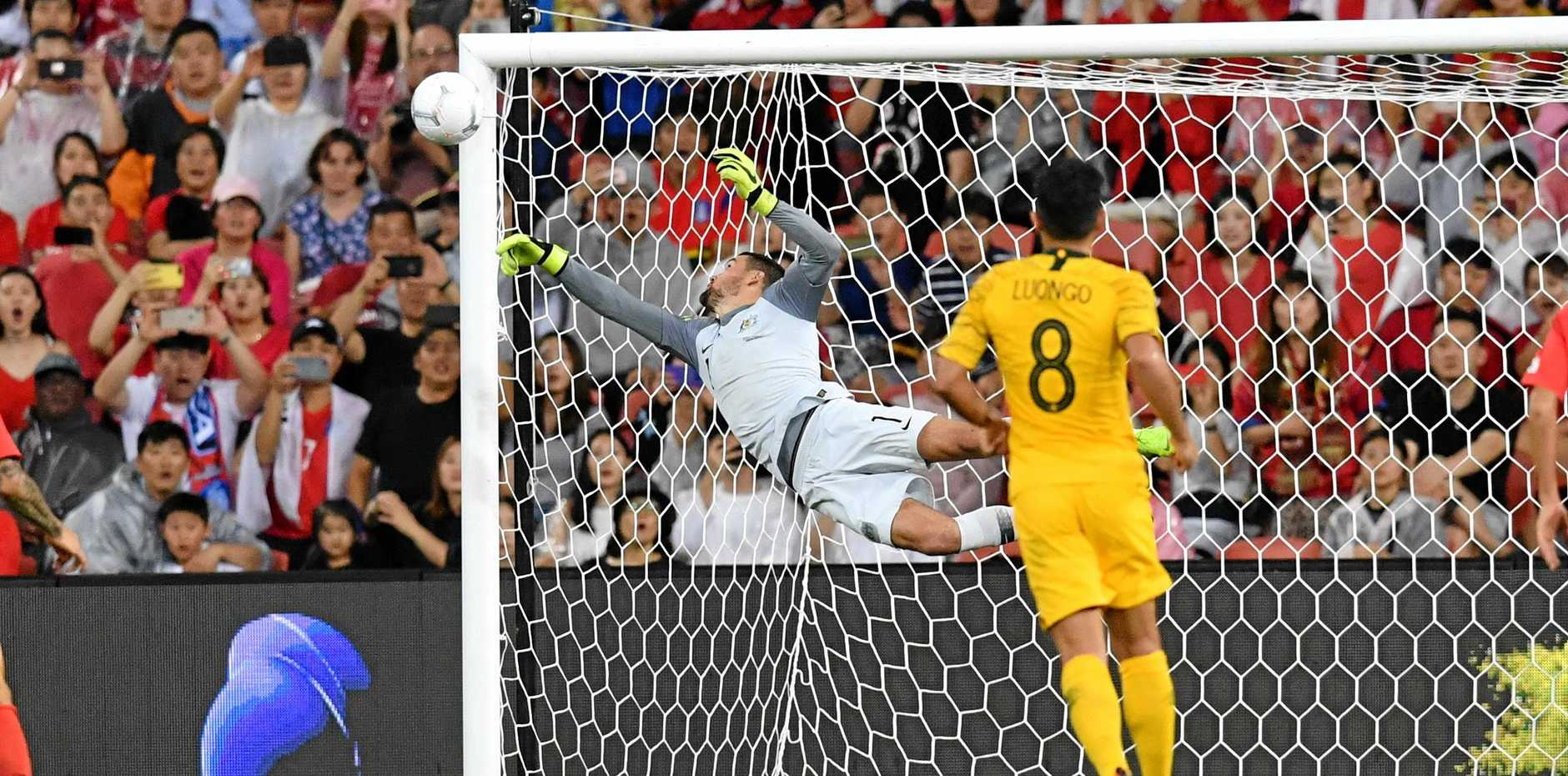 Mat Ryan makes a save for the Socceroos during their International friendly against the Korea Republic at Suncorp Stadium on November 17, 2018. Picture: Darren England/AAP