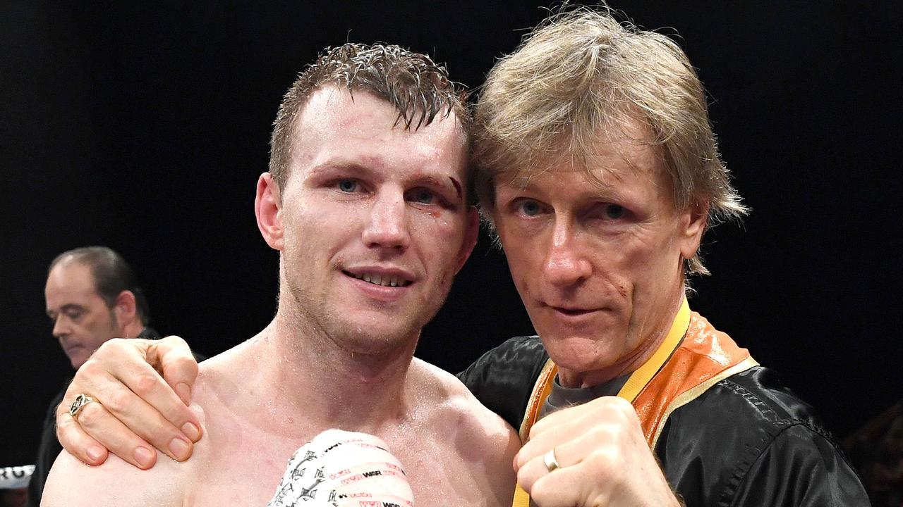 Jeff Horn's trainer Glenn Rushton (R) slammed the draw score. Picture: Bradley Kanaris/Getty