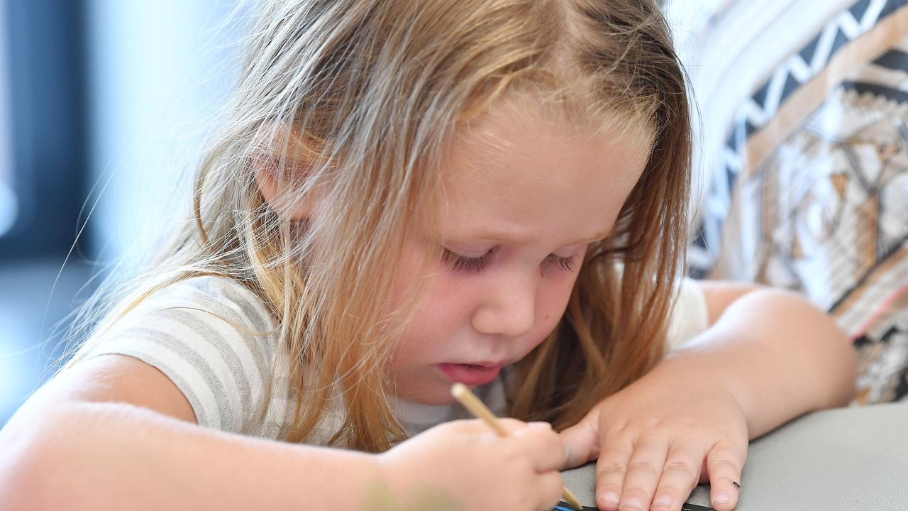 Rosie Cook, 3, concentrates on her Christmas art at the Dudley Denny City Library. Picture: Tony Martin