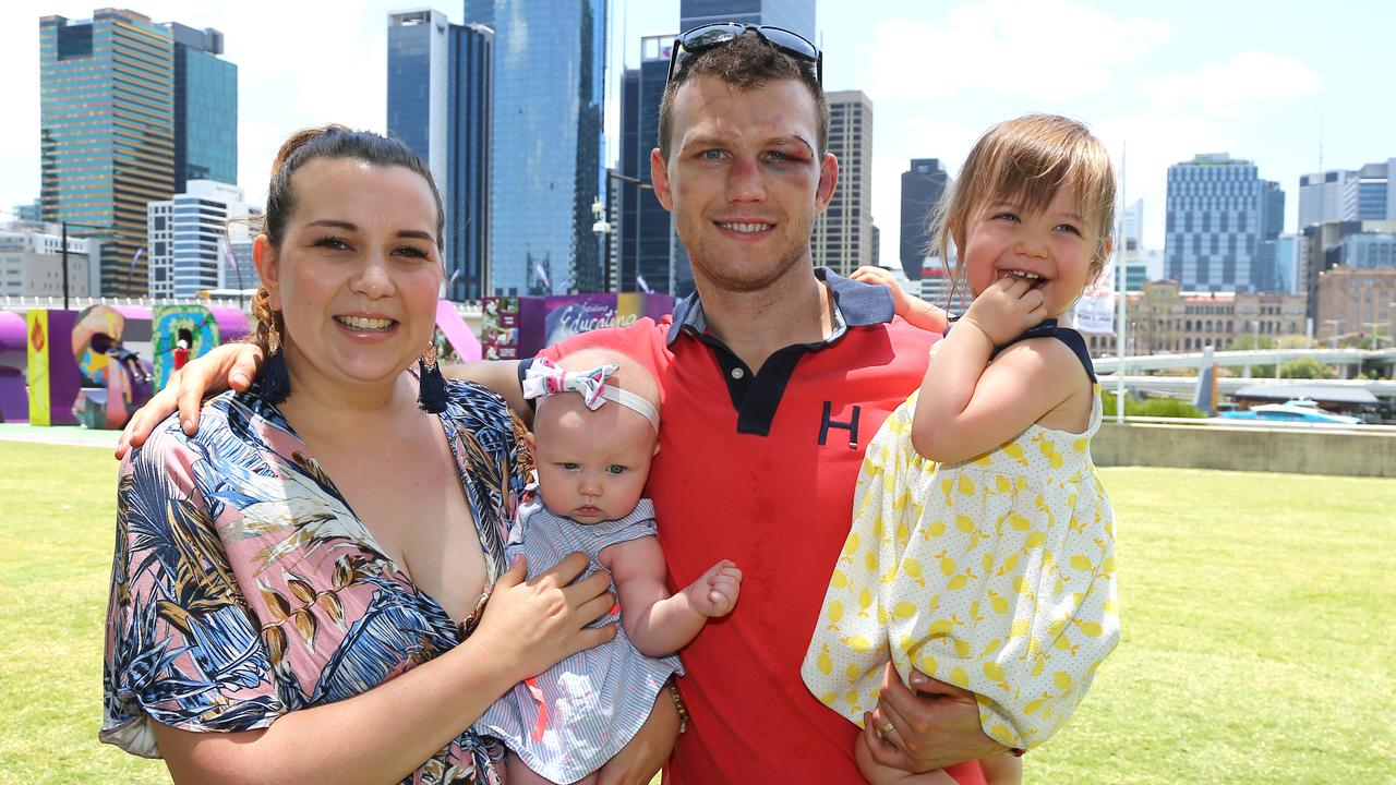 Jeff Horn with wife Jo and daughters Charlotte and Isabelle at South Bank on Thursday, following his win over Michael Zerafa. Picture: David Clark/AAP