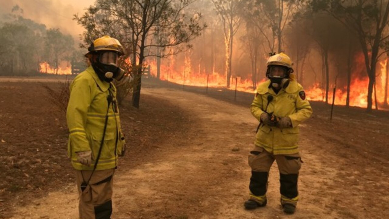 HEATING UP: The Mount Maria bushfire in Central Queensland has so far burnt through more than 1500ha. These two fire fighters are from Boyne Island Station have been on the ground working to contain the blaze.