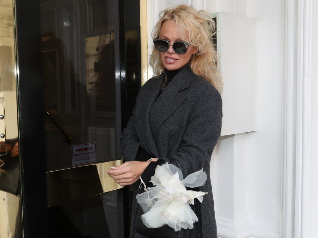 Pamela Anderson arrives to visit Julian Assange at the Ecuadorean embassy in London on February 23, 2017. Picture: Jonathan Brady/PA Wire/AAP