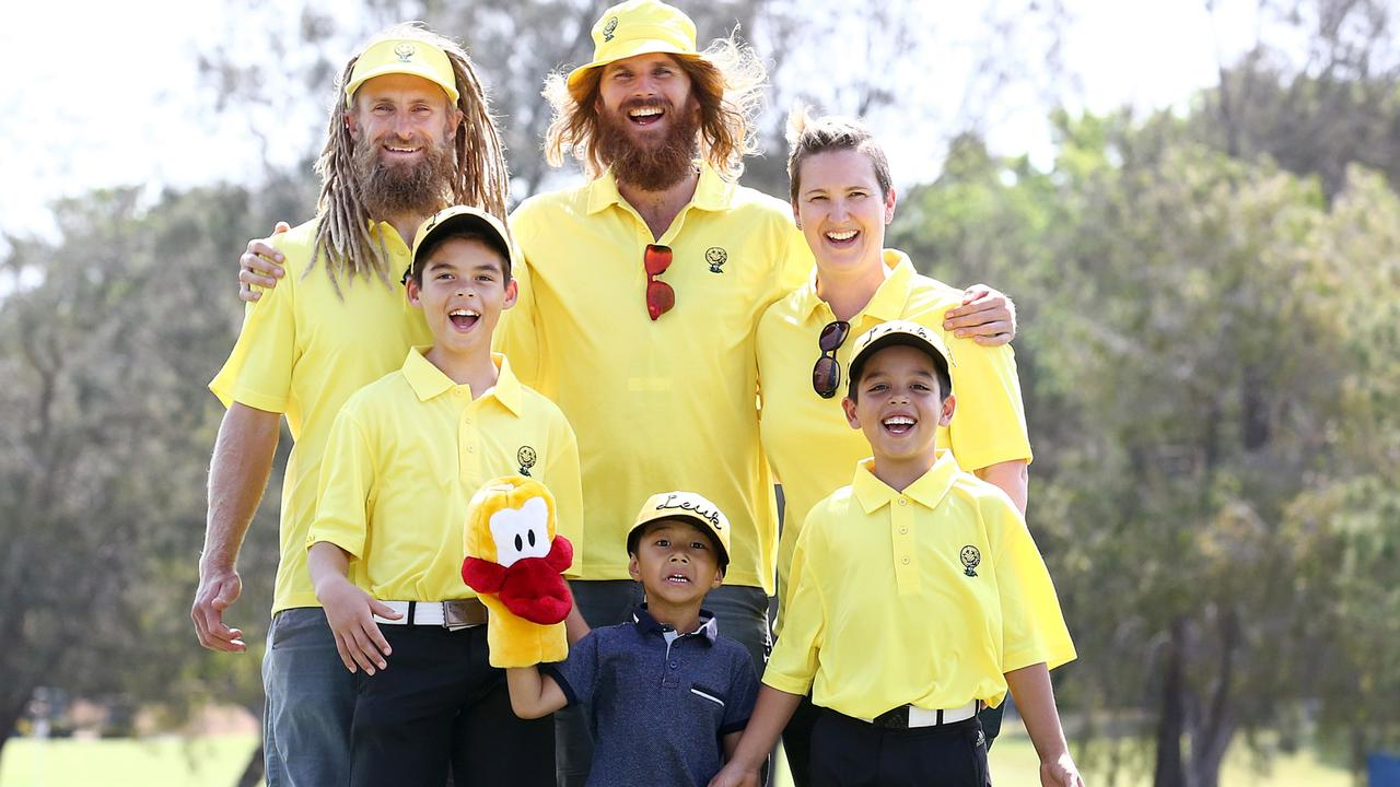 PGA GOLD COAST DAY THREE - L to R, golfer Jack Wilson, caddie Rizz O'Neill, Briony Lyle, in the Yellow Day mood to honour her late husband Jarrod Lyle on Friday at the Australian PGA - Photo: Jono Searle, PGA