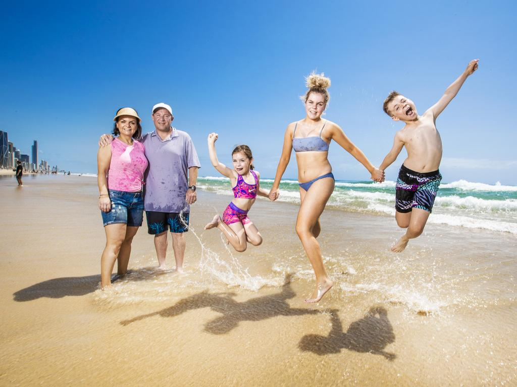 Adam and Izabella Stambanis from Melbourne with their children Ava, 6, and Cooper, 10, and niece Emily, 14, pictured on holidays at Broadbeach on the Gold Coast. Picture: Nigel Hallett