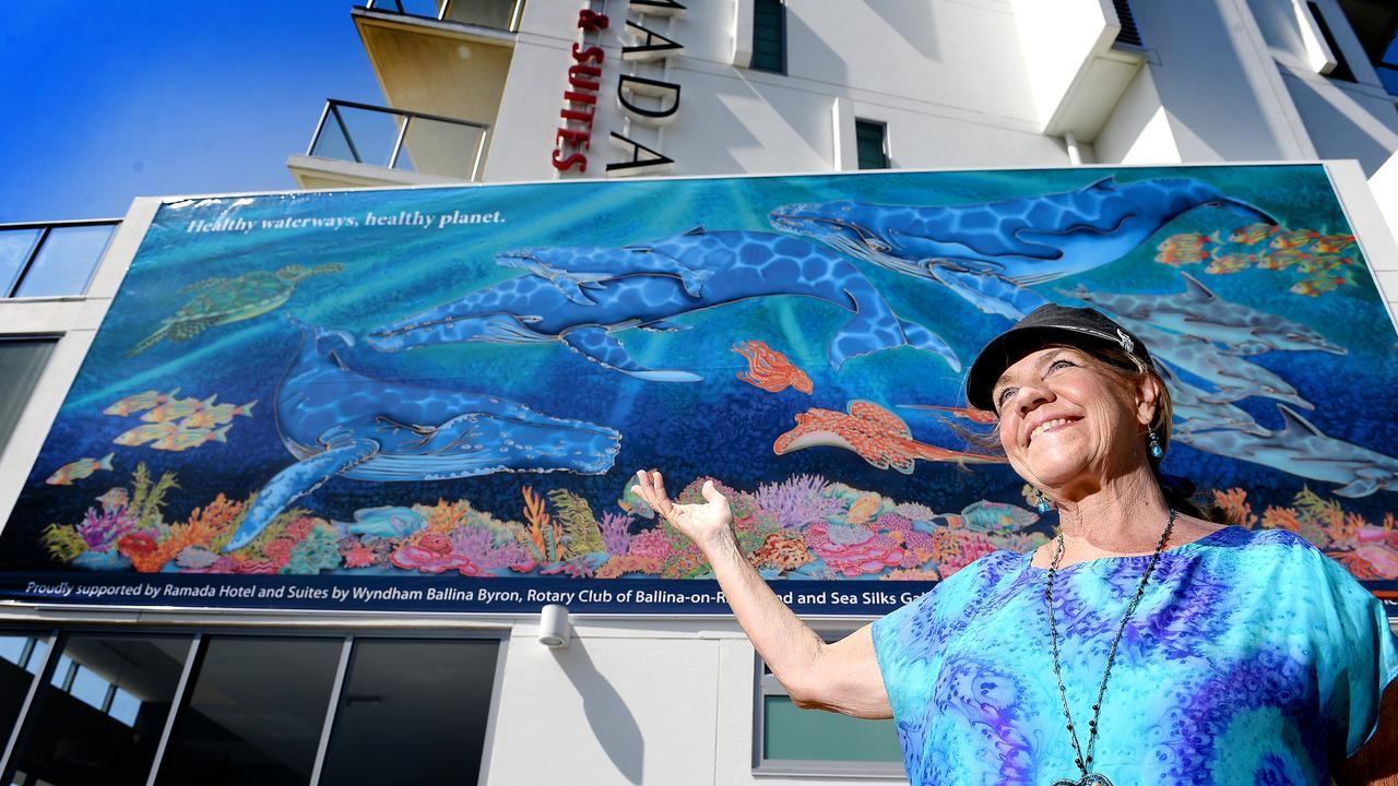 Local artist Kim Michelle Toft in front of the huge mural outside the Ramada Hotel and Suites Ballina Byron.