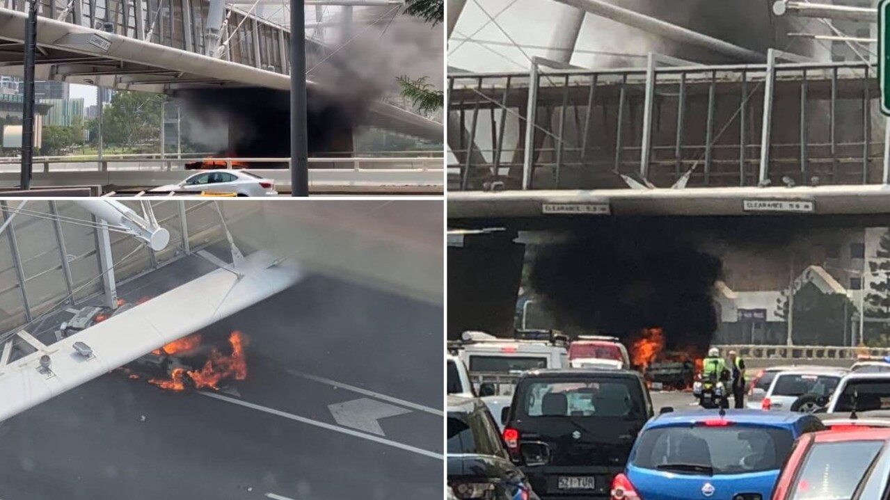 Lanes on the Riverside Expressway are closed after a car exploded into flames forcing diversions and delays.