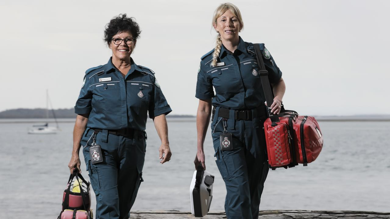 Beverly Geronimos, 59, and Vikki Harvey, 50, are volunteer paramedics, who are on-call whenever they are home on Coochiemudlo Island. Picture: Mark Cranitch.