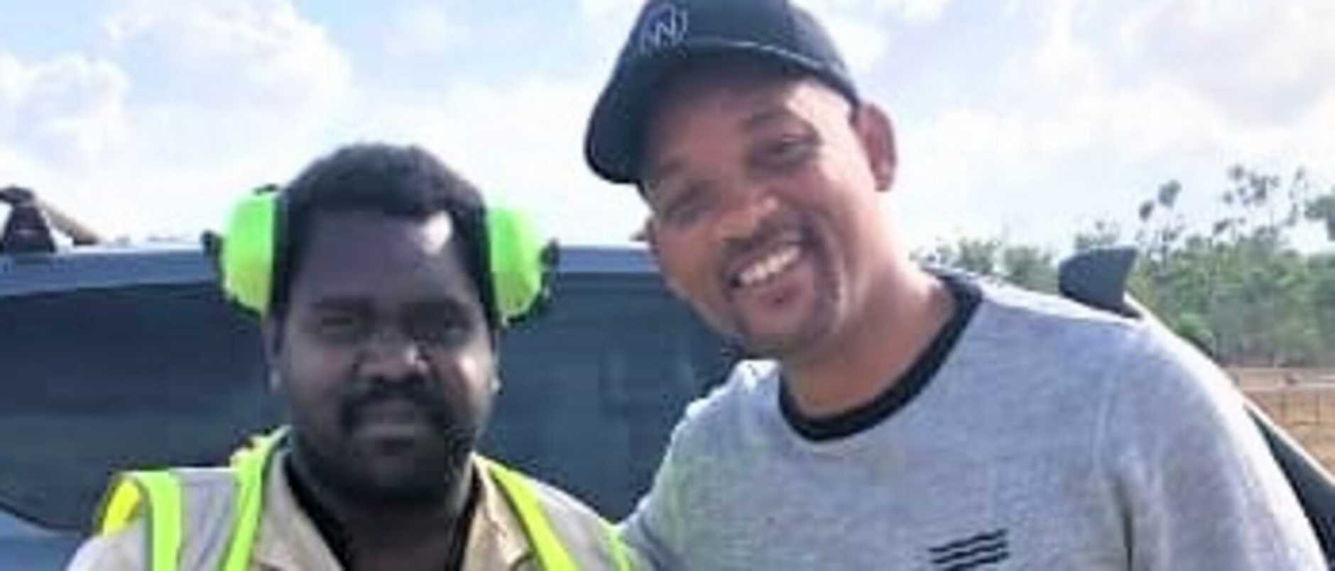 "Simon Butcher posted this photo to Facebook with the caption: ""Dad yayii with Will Smith at Lockhart River airport this morning""."