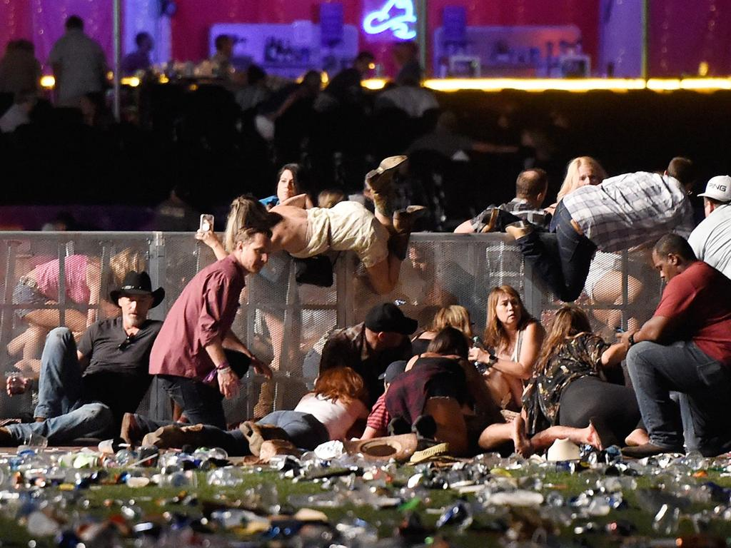People scramble for shelter at the Route 91 Harvest country music festival after gun fire from the Mandalay Bay casino, October 2017. It was America's worst mass shooting, in a decade that was full of them. Picture: David Becker/Getty Images