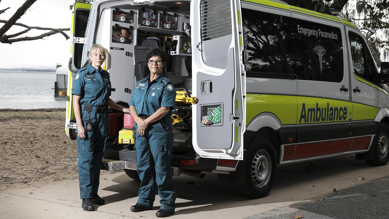 Vikki Harvey, 50, and Beverly Geronimos, 59, are volunteer paramedics, who are on-call whenever they are home on Coochiemudlo Island. Picture: Mark Cranitch.