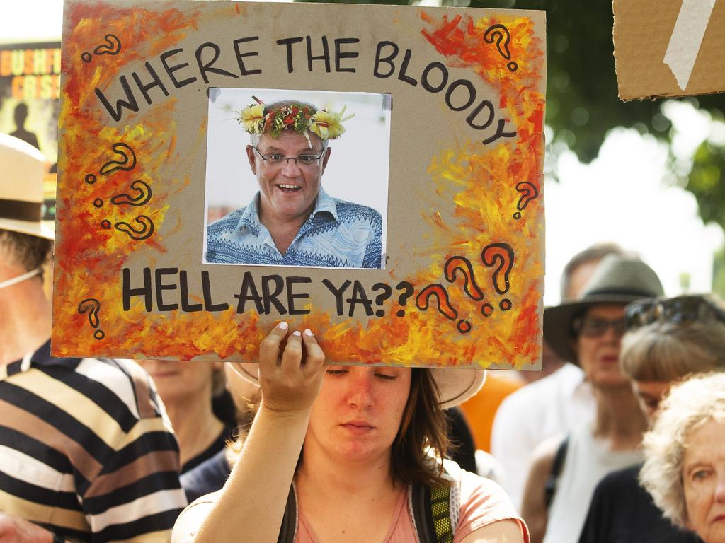 Protesters have waited outside Kirribilli House for the PM. Picture: Jenny Evans/Getty Images.