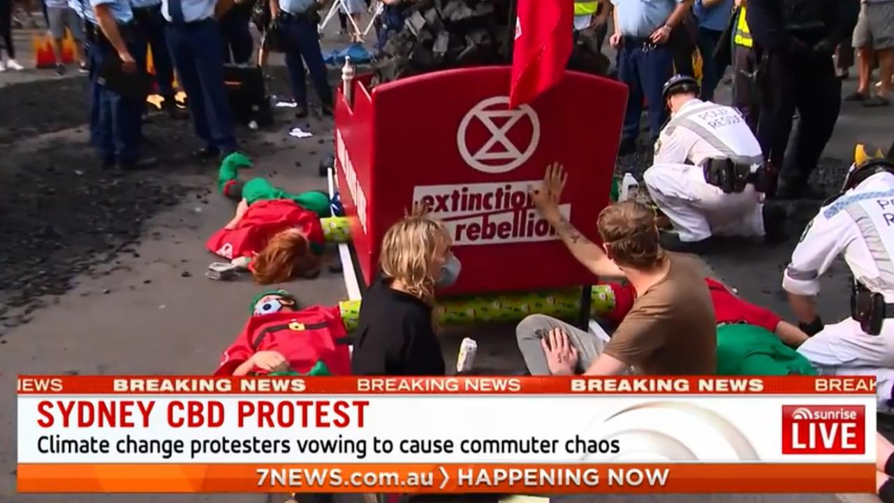 Extinction Rebellion protesters shut down Sydney CBD. Picture: Seven News