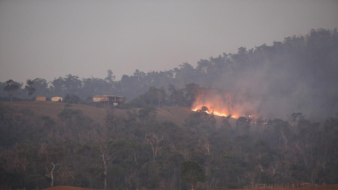 Fires still burning near properties at Adelaide Park, near Yeppoon after water-bombing aircraft worked all day to put out fires and protect property.